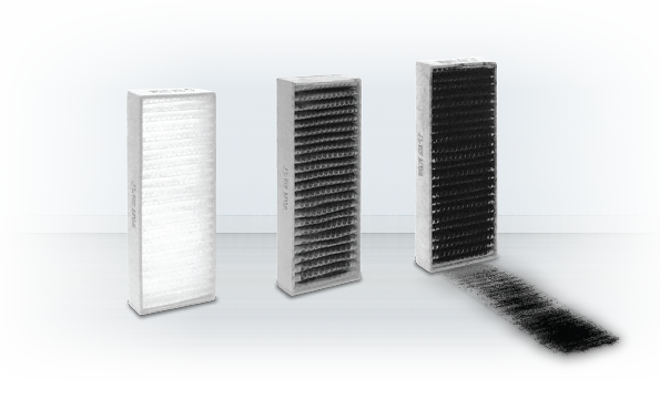 The progression of the carbon dust filter from new to used and filled with carbon dust
